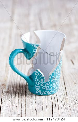 porcelain cup broken into pieces and stuck again