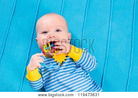 Baby Boy On Blue Knitted Blanket