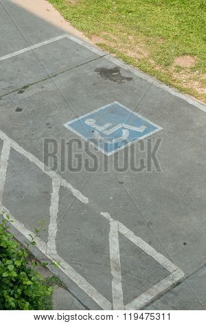 Parking Space Reserved Handicapped On Road With Disabled Sign