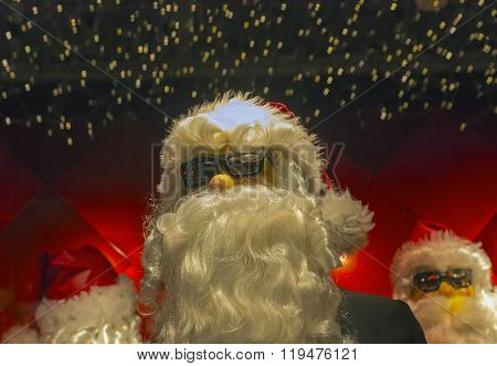 Cool Figures Of Santa Claus In Sunglasses.