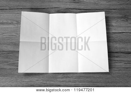 Close Up Of A Crumpled Unfolded Piece Of Paper On Wooden Background