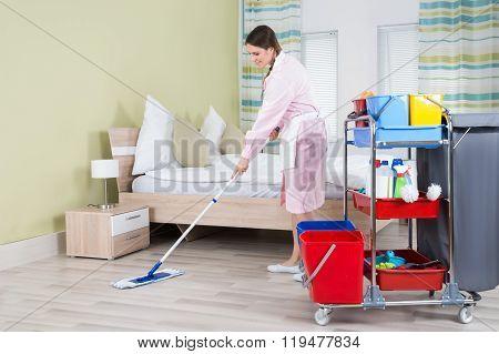 Female Housekeeper Mopping Floor