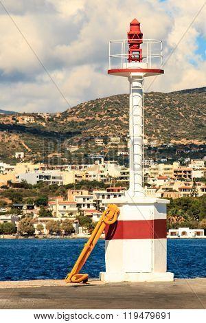 lighthouse at the port of Agios Nikolaos Greece