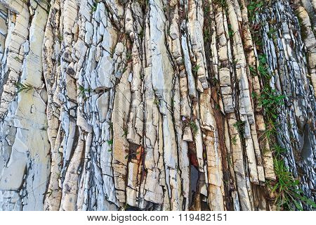 Colorful Layered Rocks And Grass. Backgrounds And Textures