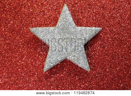 One Silver Star Shining Bright Red Luminescent Background