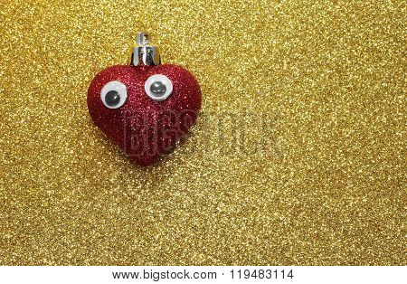 Lone Red Heart With Eyes On The Golden Background Bright Shiny
