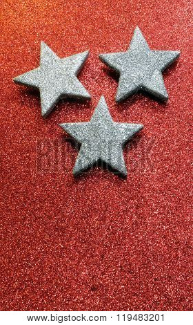 Large Silver Stars On Bright Red Glittery Illuminated Background