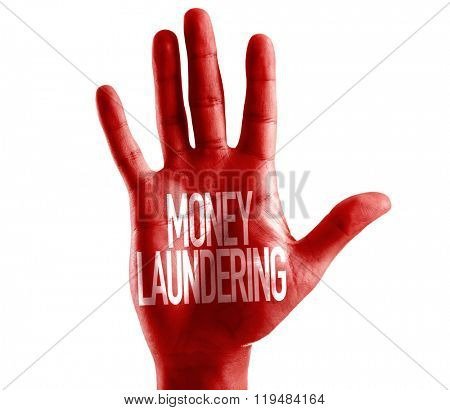 Money Laundering written on hand isolated on white background