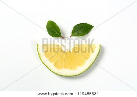 slice of green grapefruit on white background