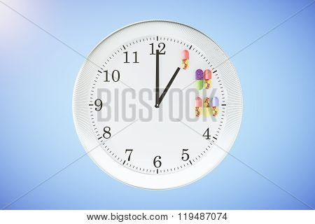 Medication Intake On Time Concept With Wall Clock And Pills