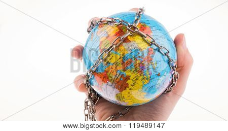Hand holding up a globe