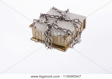 Chained white book on a white background