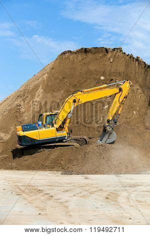 Yellow backhoe working digging