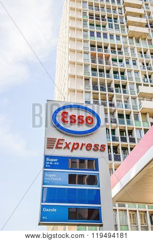 Esso Express Petrol Fuel Station With Large Appartment Building Behin