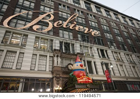NEW YORK - NOV 25 2015: The word Believe that refers to Santa Claus in lights on the side of Macy's department store that hangs above the entrance on 34th St the day before Thanksgiving in Manhattan.