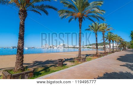 Mid morning sun on the waterfront.  Warm sunny day along the beach in Ibiza, St Antoni de Portmany B