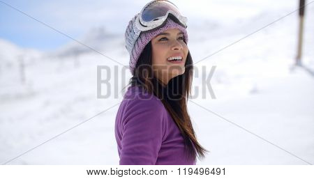 Happy beautiful young woman on a snowy mountain