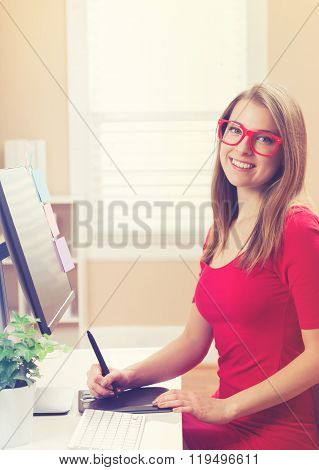 Young Woman Working With A Pen Tablet In Her Home Office