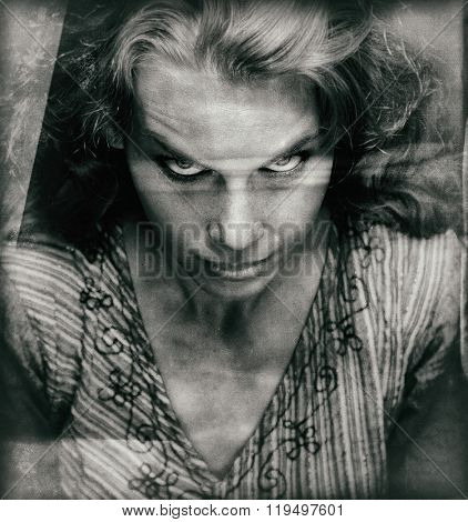 Vintage portrait of scary woman with evil looking face