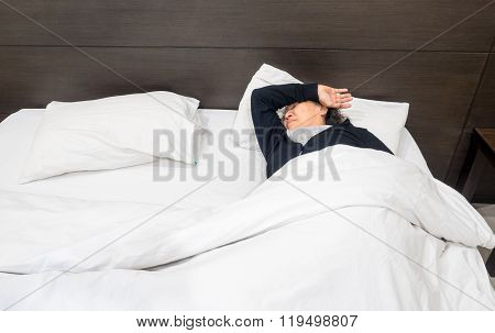 Lonely Senior Woman Sleeping In The Bed