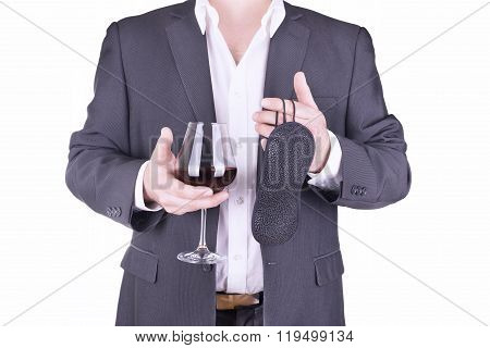 Businessman holding glass of wine and blindfold. Isolated on white background.