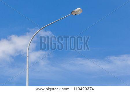 A Street Light Pole With Beautiful Blue Sky Background.