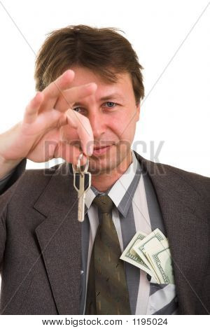 Businessman With Money And Key