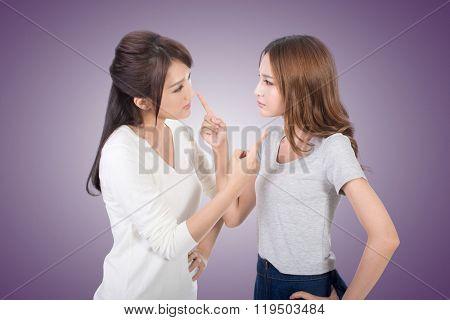 Friend arguing, two asian women.