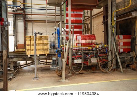 Production equipment in shop for brick production