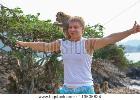 Tourists In Thailand With Monkeys.