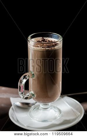 A glass of cocoa on a dark background