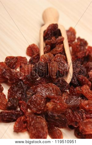 Brown Raisins With Spoon On Wooden Table, Healthy Eating