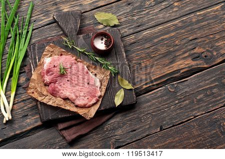 Juicy Piece Of Meat, Sprig Of Rosemary, Onion, Bay Leaf