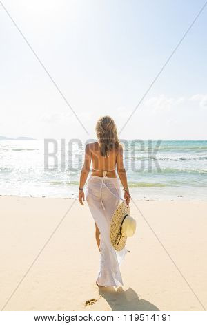 Classy woman at the beach
