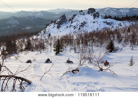 Walk on snowmobiles in the mountains of the Southern Urals.