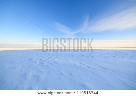 Frozen lake scape and blue sky