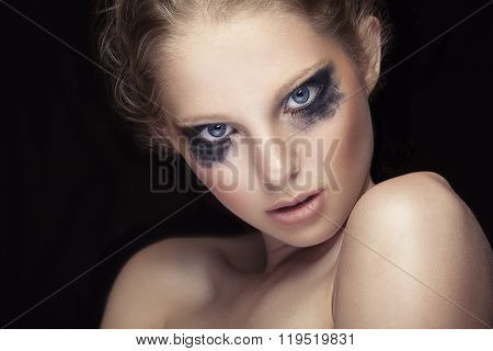 Girl With Crying Make Up On Black Background