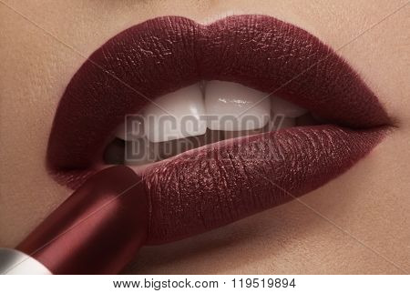 Applying Red Lipstick On Lips In Close Up Photo