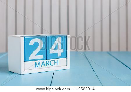 March 24th. Image of march 24 wooden color calendar on white background.  Spring day, empty space fo