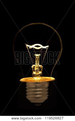 Incandescent Light Bulb On Black Background