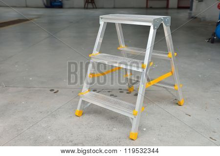 Picture Of A Small Foldable Ladder In A Car Wash