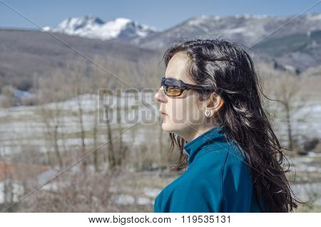 Woman Trekking In Winter Mountains.
