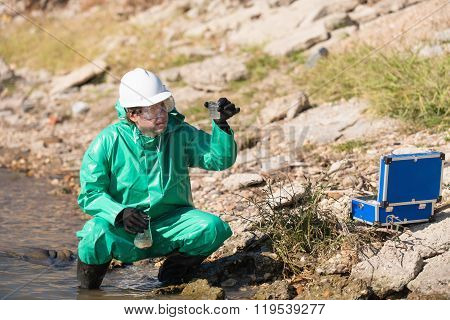 Environmentalist With Samples Od Polluted Water