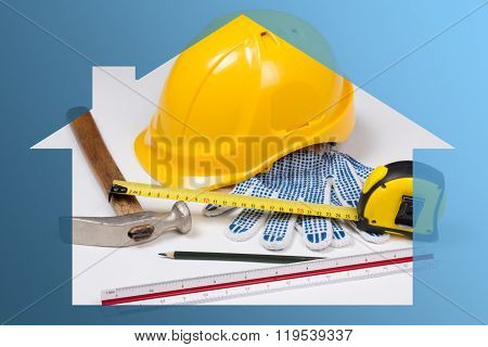 Construction Concept - Builder's Work Tools In Blue House