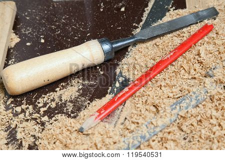 carpenter tools lying on wood chips