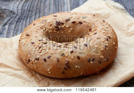 Fullgrain Bagel With Seeds On Wooden Table