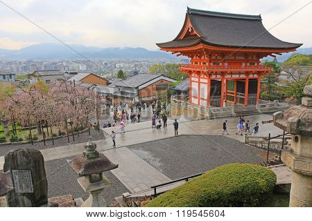 KYOTO, JAPAN - APRIL 2015 : Evening view of the people walking near Deva Gate with Kyoto city in the background at Kiyomizu-dera Temple in Kyoto, Japan on April 15, 2015.