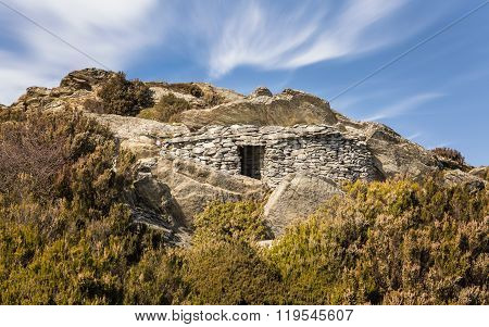 Stone Shelter Built Into Rock In The Mountains Of Corsica