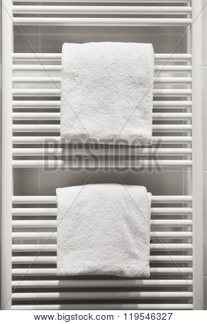 two white towels on heating radiator
