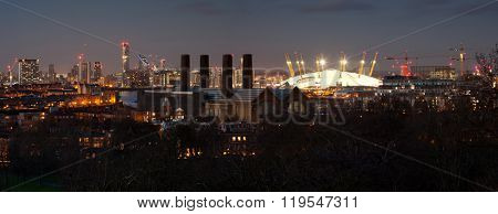 London, UK - JANUARY 7, 2016: Panorama of Canary Wharf in night. View includes the park, National Maritime Museum,  Royal chapel, Painted hall and O2.